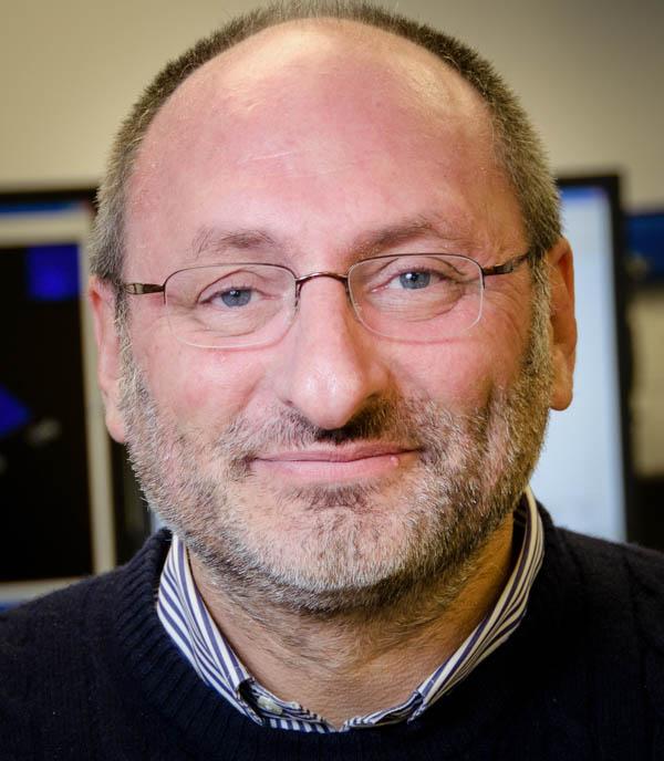 Portrait headshot of Professor Fabien Kenig. Man with very short brown, gray hair and glasses.
