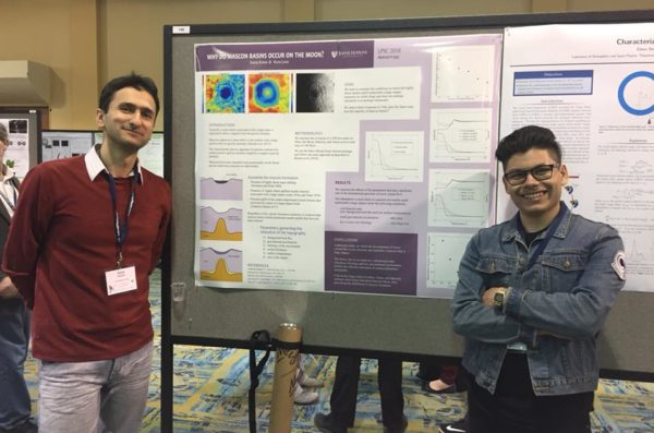 Students presenting a poster at a conference