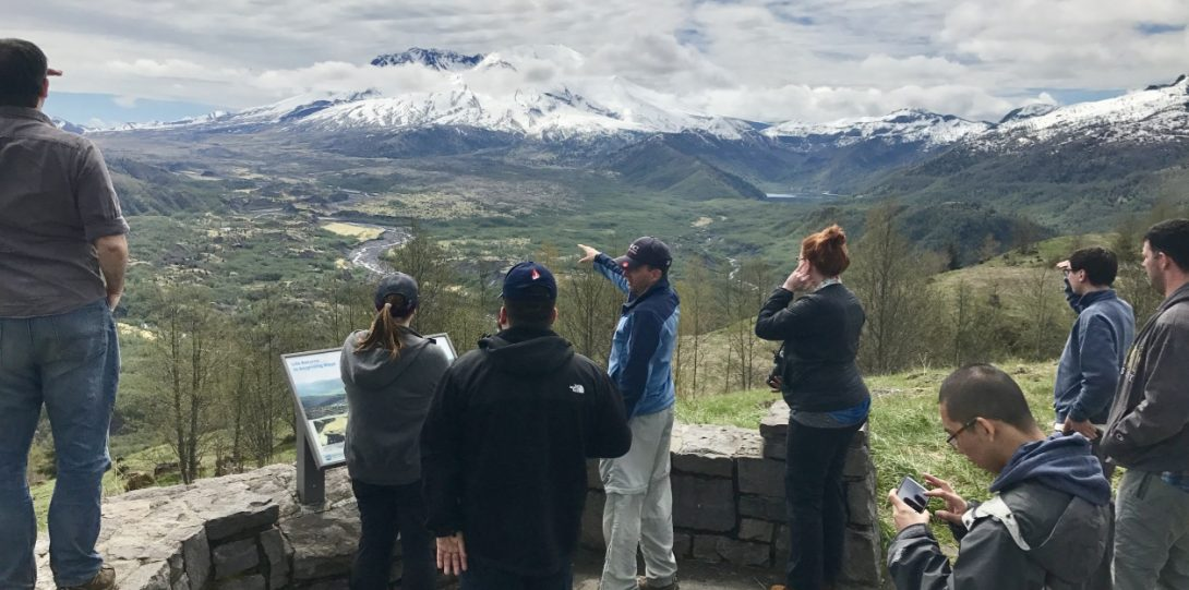 Group of students and faculty looking at Mt. St. Helens